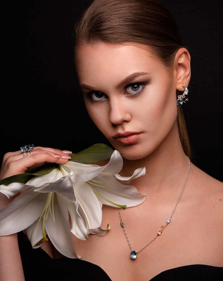 Elegant model with gemstone jewellery from Celestial collection.