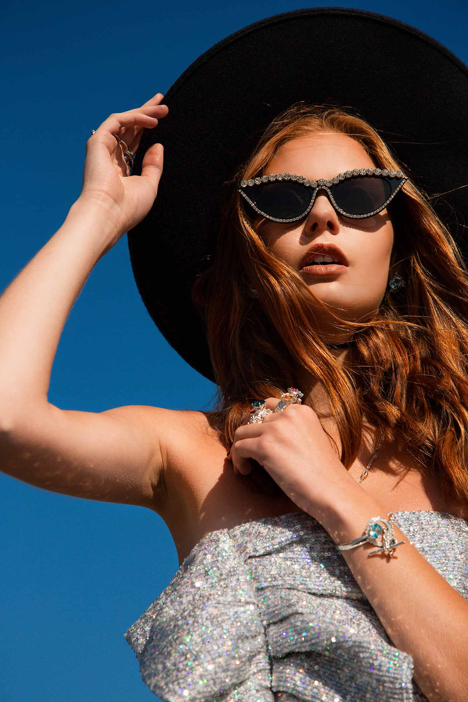 Fashion model wearing contemporary jewelry from Celestial collection.